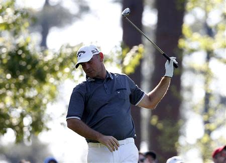 Denmark's Thomas Bjorn reacts after his tee shot on the fourth hole during the second round of the Masters golf tournament at the Augusta National Golf Club in Augusta