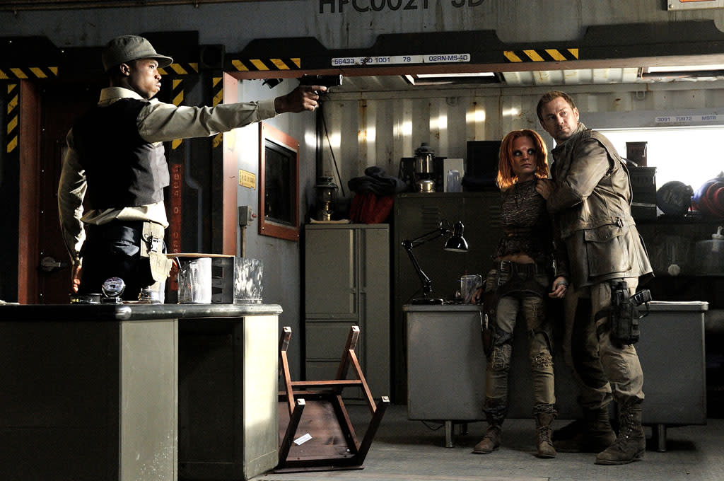 "Dewshane Williams as Tommy LaSalle, Stephanie Leonidas as Irisa, and Grant Bowler as Joshua Nolan in the ""Defiance"" episode, ""I Just Wasn't Made for These Times."""