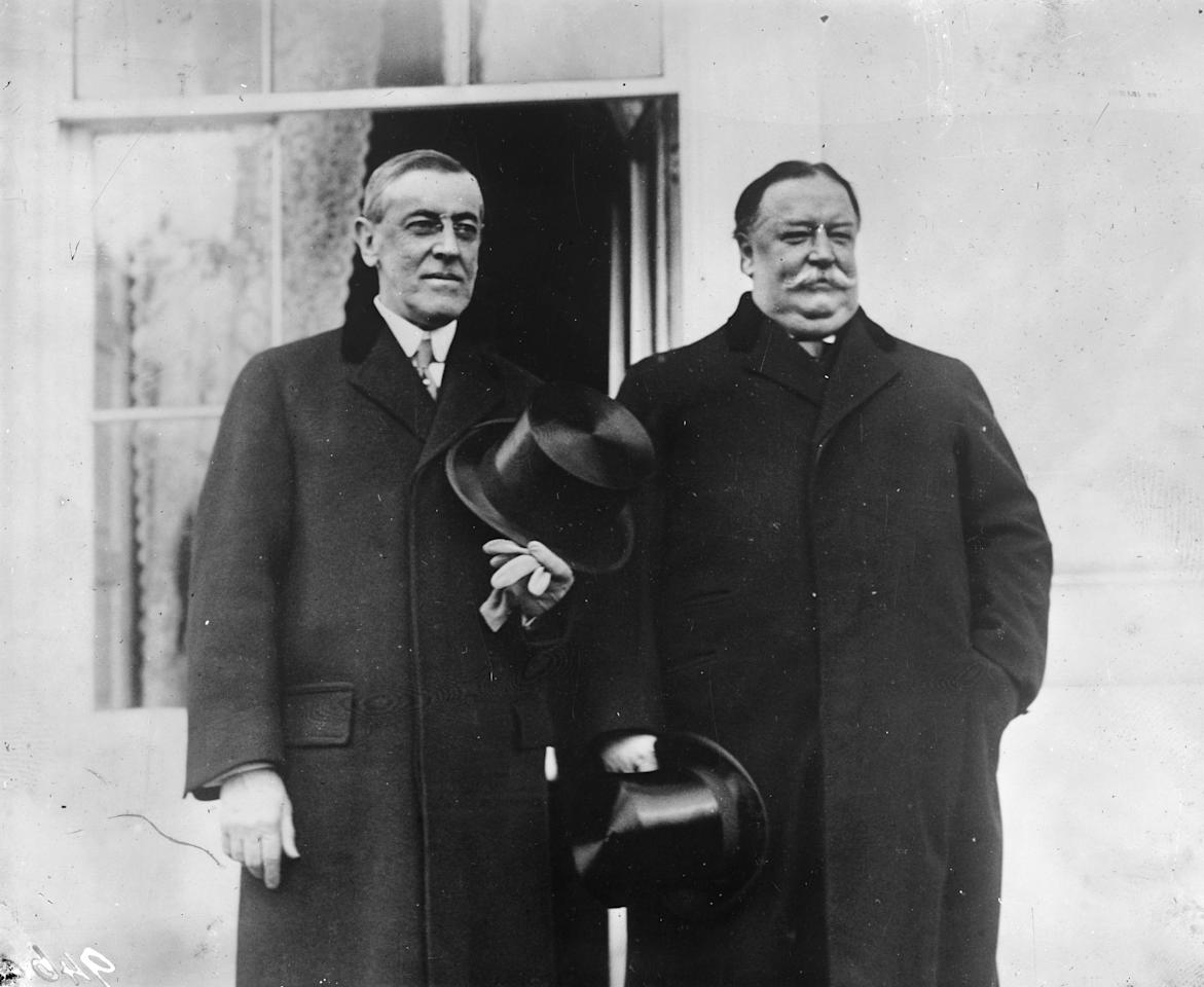 Former American President William Howard Taft (1857 - 1930), right, and Woodrow Wilson (1856 - 1924), at Wilson's inauguration as the 28th President of the United States of America.   (Photo by Topical Press Agency/Getty Images)