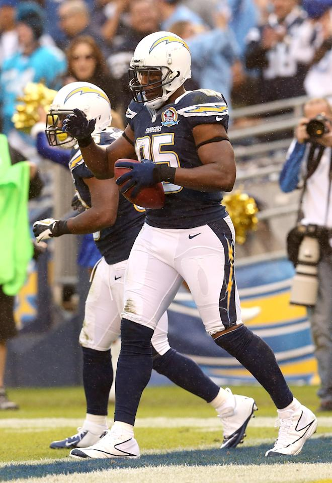 SAN DIEGO, CA - DECEMBER 16: Tight end Antonio Gates #85 of the San Diego Chargers celebrates after catching a nine yard touchdown pass in the fourth quarter against the Carolina Panthers at Qualcomm Stadium on December 16, 2012 in San Diego, California. The catch tied Gates with Lance Alworth for most career touchdown catches by a Charger.  The Panthers won 31-7.  (Photo by Stephen Dunn/Getty Images)