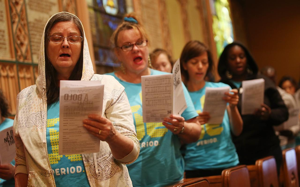 NEW YORK, NY - JULY 14: People sing during services honoring Trayvon Martin at Middle Collegiate Church in Manhattan on July 14, 2013 in New York City. George Zimmerman was acquitted of all charges in the shooting death of Martin July 13 and some congregants wore hoodies during the service to honor Martin. (Photo by Mario Tama/Getty Images)