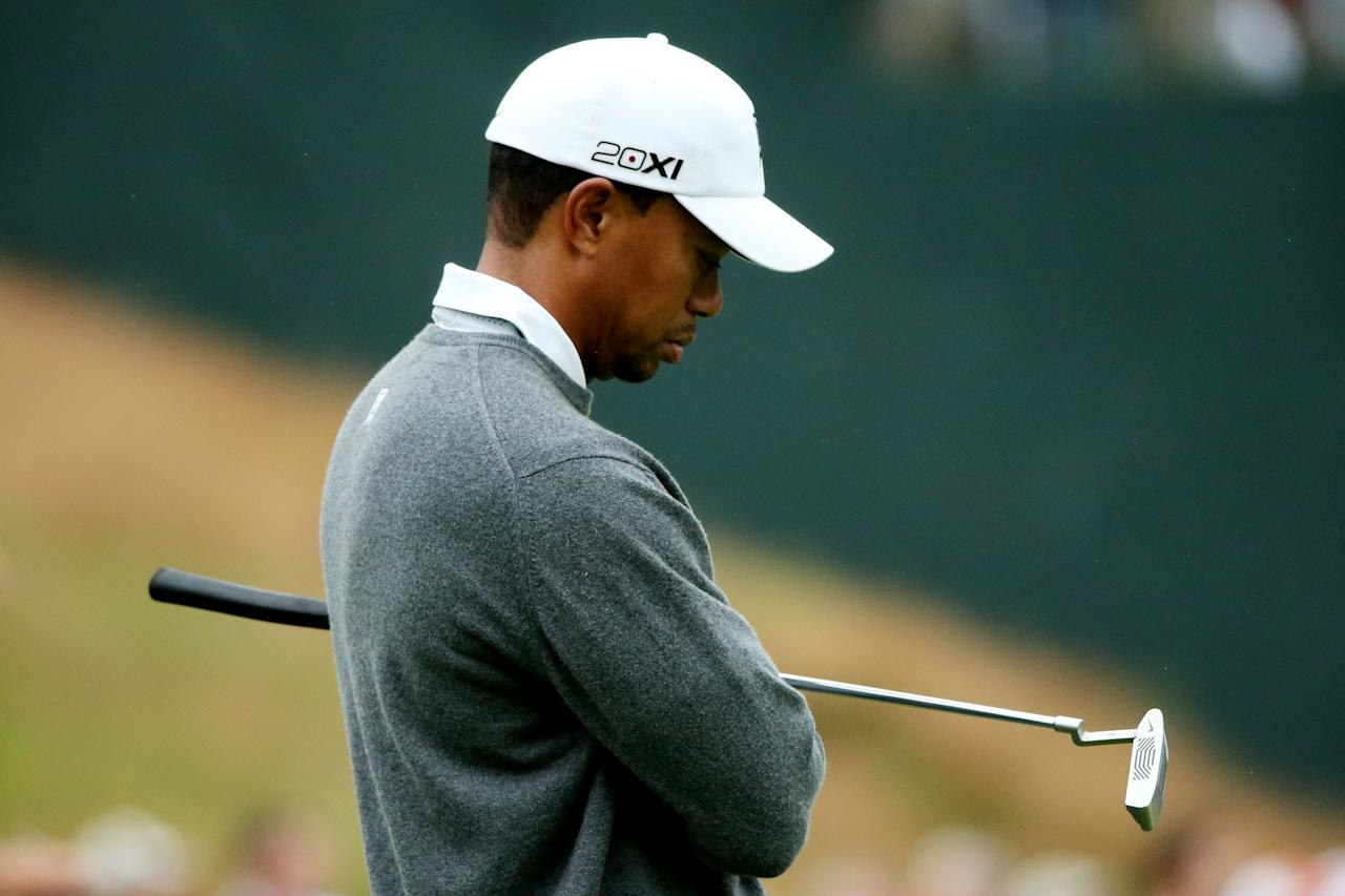 ARDMORE, PA - JUNE 14: Tiger Woods of the United States reacts on the 16th green during a continuation of Round One of the 113th U.S. Open at Merion Golf Club on June 14, 2013 in Ardmore, Pennsylvania.  (Photo by Andrew Redington/Getty Images)