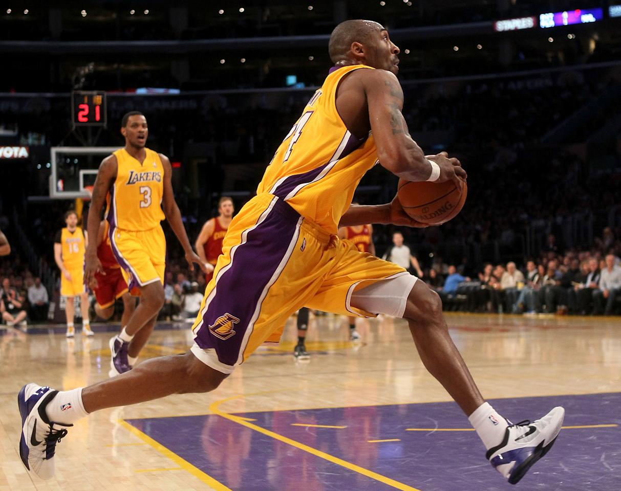 LOS ANGELES, CA - JANUARY 13:  Kobe Bryant #24 of the Los Angeles Lakers drives in for a basket against the Cleveland Cavaliers at Staples Center on January 13, 2012 in Los Angeles, California.  NOTE TO USER: User expressly acknowledges and agrees that, by downloading and or using this photograph, User is consenting to the terms and conditions of the Getty Images License Agreement.  (Photo by Stephen Dunn/Getty Images)