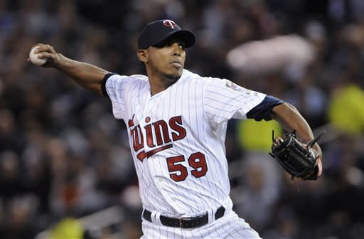 Minnesota Twins pitcher Esmerling Vasquez throws to a New York Yankees batter druing the first inning of a baseball game Tuesday, Sept. 25, 2012, in Minneapolis. (AP Photo/Jim Mone)