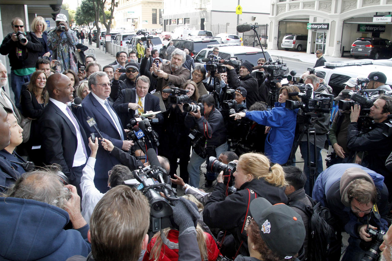 Barry Bonds, left, and his attorney Allen Ruby face the media outside a federal court building Wednesday, April 13, 2011, in San Francisco. The former baseball player was convicted of one count of obstruction of justice. The jury failed to reach a verdict on the three counts at the heart of allegations that he knowingly used steroids and human growth hormone and lied to a grand jury about it.