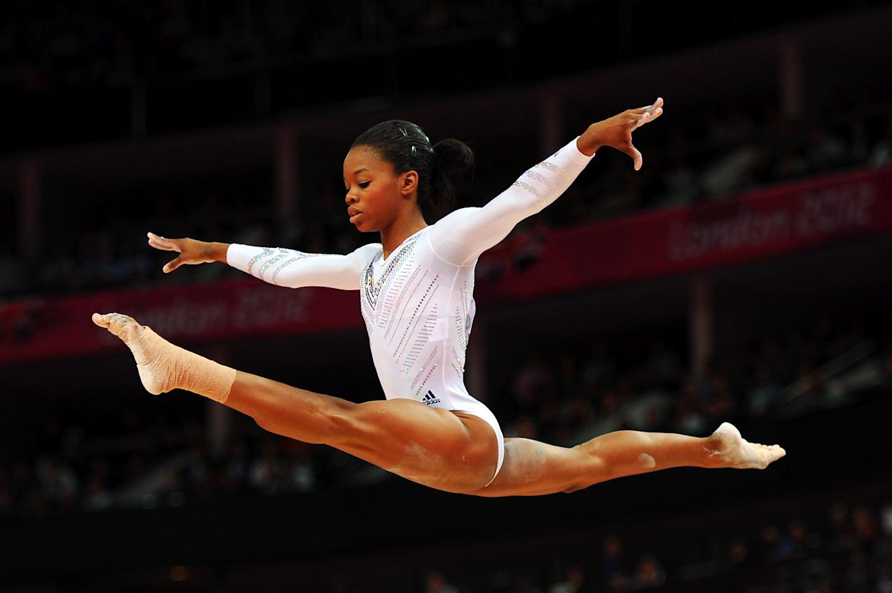 Gabrielle Douglas of the United States competes on the beam during the Artistic Gymnastics Women's Beam final on Day 11 of the London 2012 Olympic Games at North Greenwich Arena on August 7, 2012 in London, England.  (Photo by Michael Regan/Getty Images)