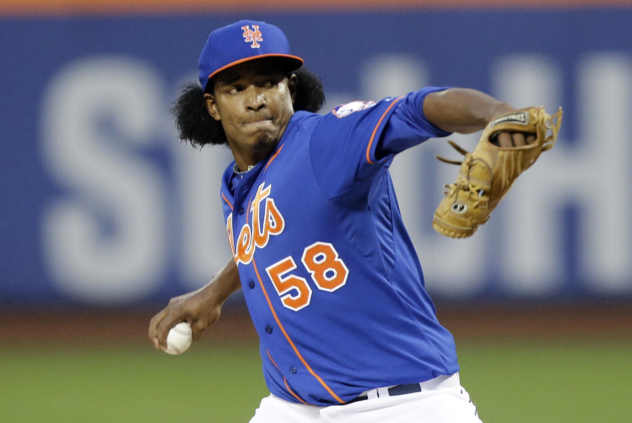 New York Mets' Jenrry Mejia delivers a pitch during the first inning of a baseball game against the Philadelphia Phillies, Friday, May 9, 2014, in New York. (AP Photo/Frank Franklin II)