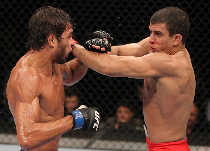 BELO HORIZONTE, BRAZIL - JUNE 23:   (R-L) Felipe Arantes and Milton Vieira exchange punches  during their UFC 147 featherweight bout at Estadio Jornalista Felipe Drummond on June 23, 2012 in Belo Horizonte, Brazil.