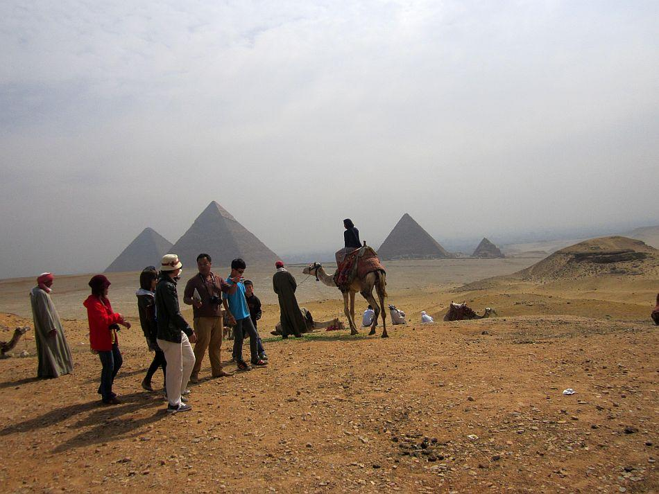 "An Egyptian sunrise at Giza<br><br><b>ABOUT THE PHOTOGRAPHER</b><br><br> <p><img style="""" src=""http://l.yimg.com/t/images/svetlana-baghawan-80.jpg""><b>SVETLANA BAGHAWAN</b> worked for 13 years as a flight attendant, a job that gave her the opportunity to travel and explore places close to her heart and of her dreams. Now blessed with a four-year-old daughter, she runs a beauty salon and spa in Kolkata but her restless traveler's spirit never leaves her alone. Thanks to her supportive husband and family, she backpacks as a single woman traveler all over the world at least four times a year, mostly with her four-year-old budding traveler in tow.</p>"