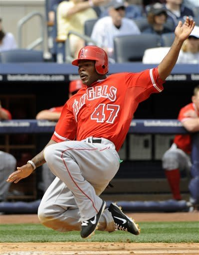 Los Angeles Angels' Howie Kendrick scores ona double by Albert Pujols during the third inning of a baseball game against the New York Yankees  Saturday, April 14, 2012 at Yankee Stadium in New York. (AP Photo/Bill Kostroun)