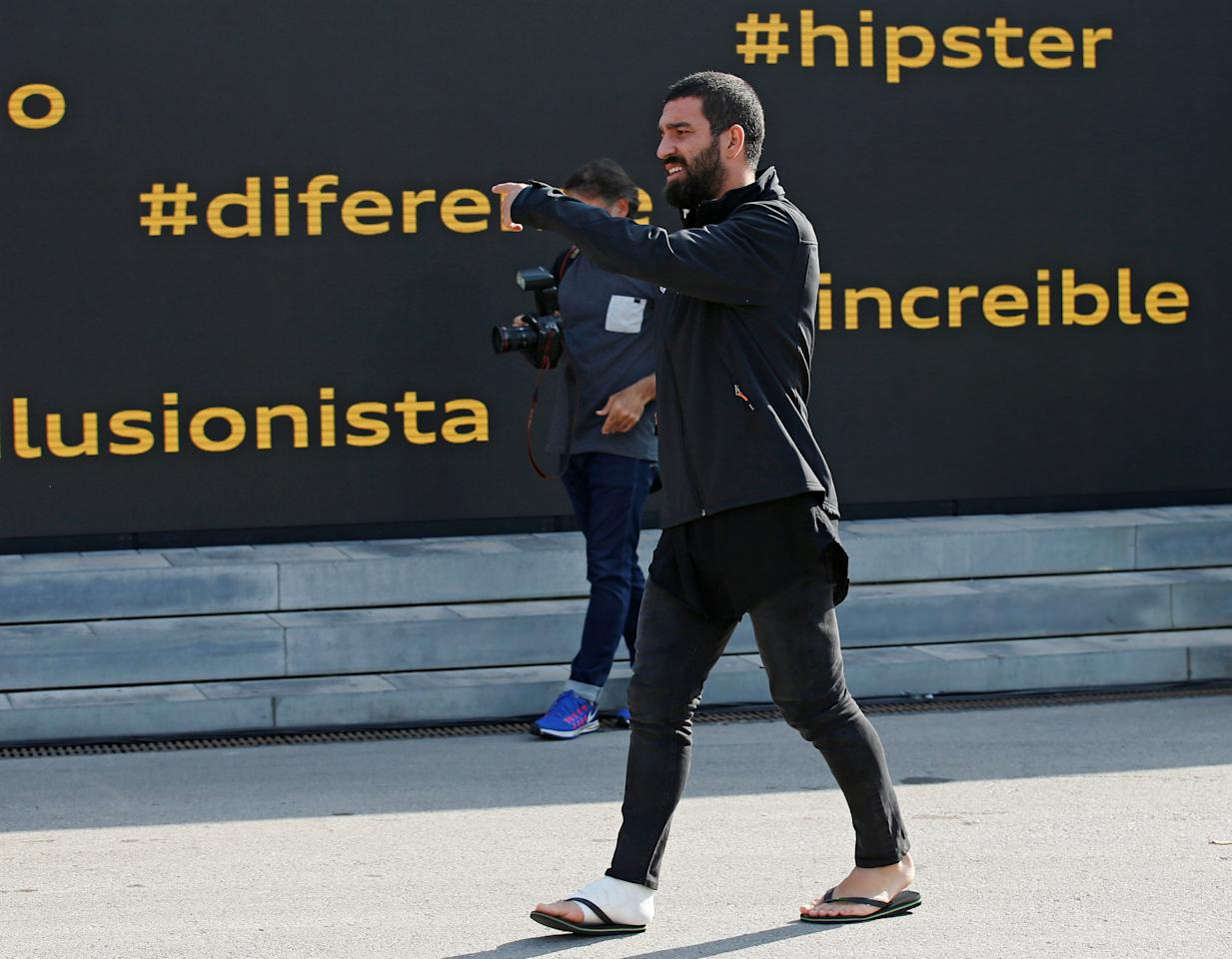 Barcelona's injured soccer player Arda Turan takes part in a commercial event near Camp Nou stadium in Barcelona, Spain October 27, 2016. REUTERS/Albert Gea