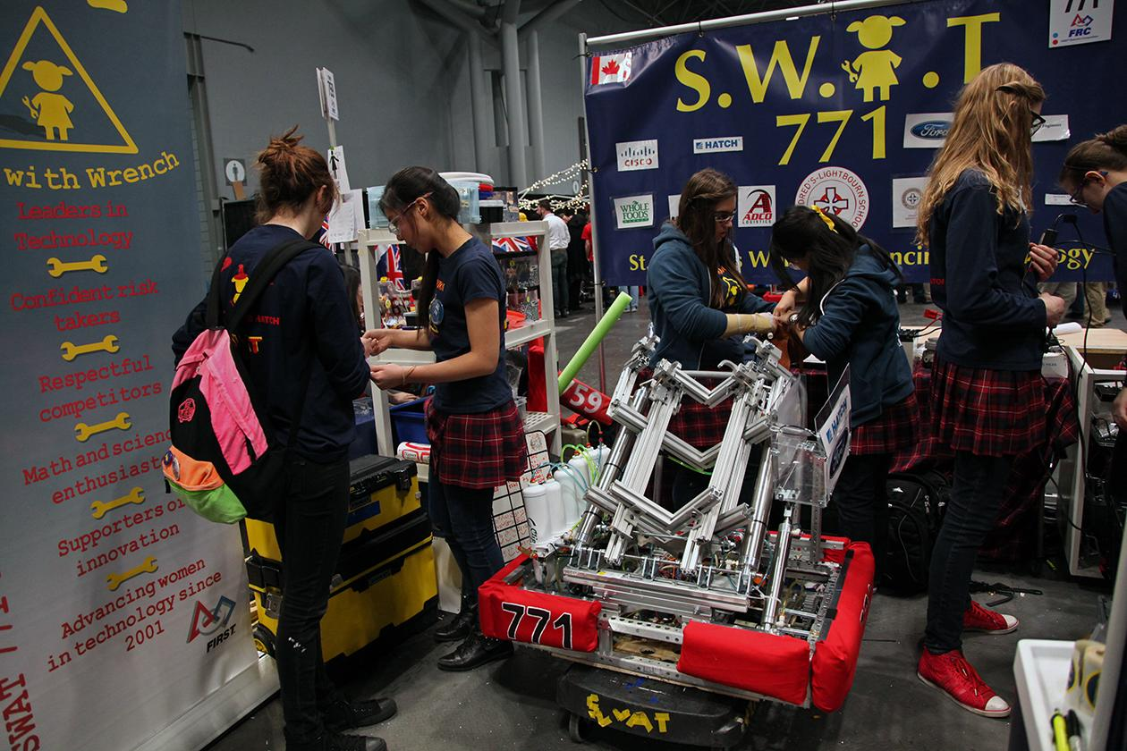 Robotics team of St. Mildred's Women Advancing Technology (S.W.AT 771) in their pit.