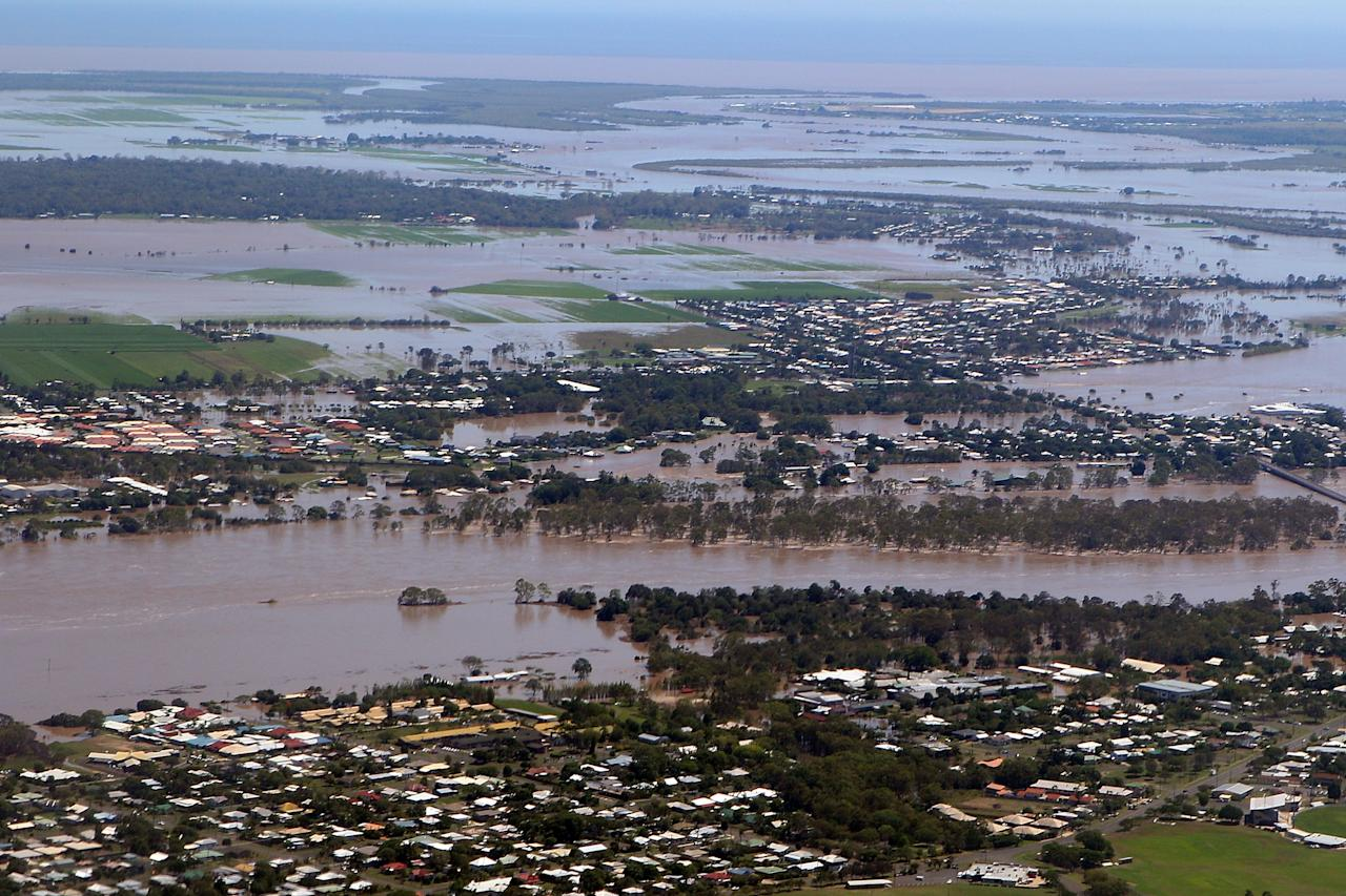 BUNDABERG, AUSTRALIA - JANUARY 29:  Aerial view of Bundaberg shows flooding   as parts of southern Queensland experiences record flooding in the wake of Tropical Cyclone Oswald on January 29, 2013 in Bundaberg, Australia.Four deaths have been confirmed and thousands have been evacuated in Bundaberg as the city faces it's worst flood disaster in history. Rescue and evacuation missions continue today as emergency services prepare to move patients from Bundaberg Hospital to Brisbane amid fears the hospital could lose power.  (Photo by Chris Hyde/Getty Images)