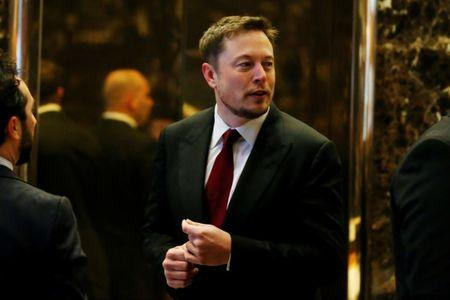 Elon Musk enters the lobby of Trump Tower in Manhattan New York