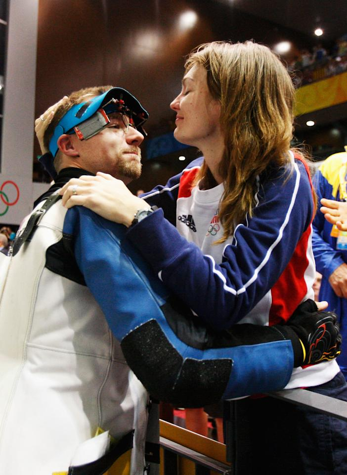 BEIJING - AUGUST 15: Matthew Emmons (L) of the United States is congratulated by his wife Katerina Emmons after winning silver medal in the Men's 50m Rifle Prone Final at the Beijing Shooting Range Hall on Day 7 of the Beijing 2008 Olympic Games on August 15, 2008 in Beijing, China.  (Photo by Streeter Lecka/Getty Images)