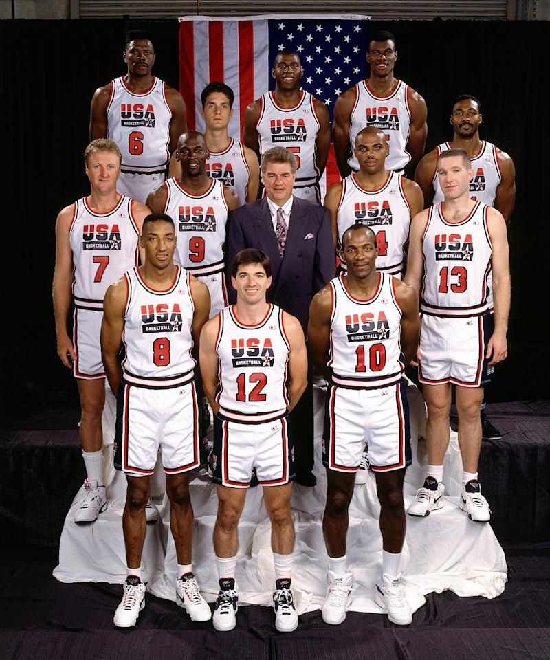 BARCELONA, SPAIN - 1991:  The original Olympic Dream Team pose for a group photo from back row (L-R) Patrick Ewing, Christian Laetner, Magic Johnson, David Robinson and Karl Malon.  Middle row (L-R) Larry Bird, Michael Jordan, head coach Chuck Daly, Charles Barkley and Chris Mullin. Bottom row (L-R) Scottie Pippen, John Stockton and Clyde Drexler in Barcelona, Spain in 1991.  NOTE TO USER: User expressly acknowledges that, by downloading and or using this photograph, User is consenting to the terms and conditions of the Getty Images License agreement. Mandatory Copyright Notice: Copyright 1991 NBAE (Photo by Andrew D. Bernstein/ NBAE/ Getty Images)