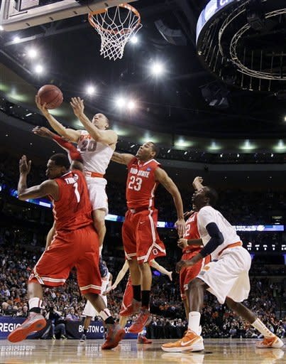 Syracuse guard Brandon Triche (20) drives against Ohio State forward Deshaun Thomas (1) and center Amir Williams (23) during the first half of the East Regional final game in the NCAA men's college basketball tournament, Saturday, March 24, 2012, in Boston. (AP Photo/Elise Amendola)
