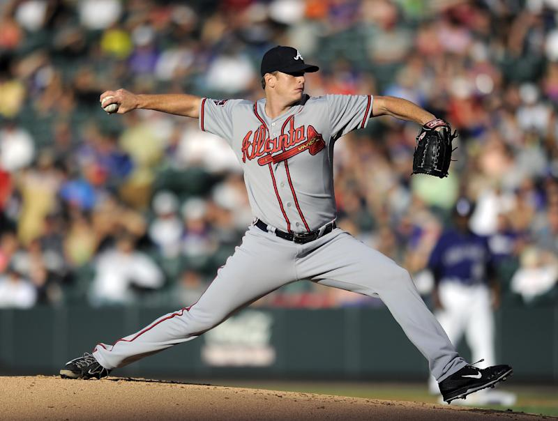 Floyd pitches Braves past Rockies 3-1