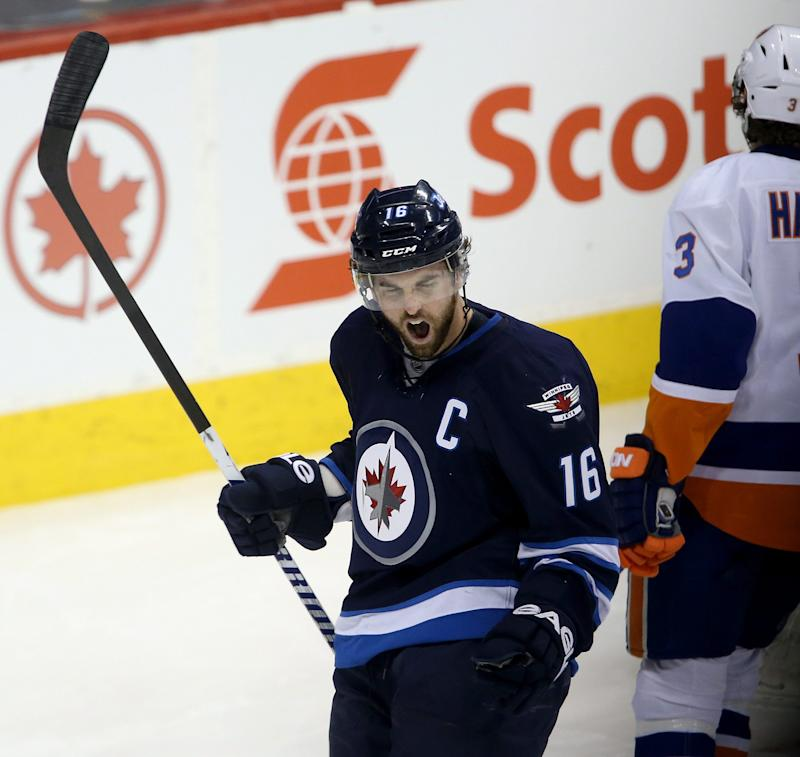 Winnipeg Jets' Andrew Ladd (16) celebrates his goal against the New York Islanders during the first period of an NHL hockey game in Winnipeg, Manitoba, Tuesday, March 4, 2014