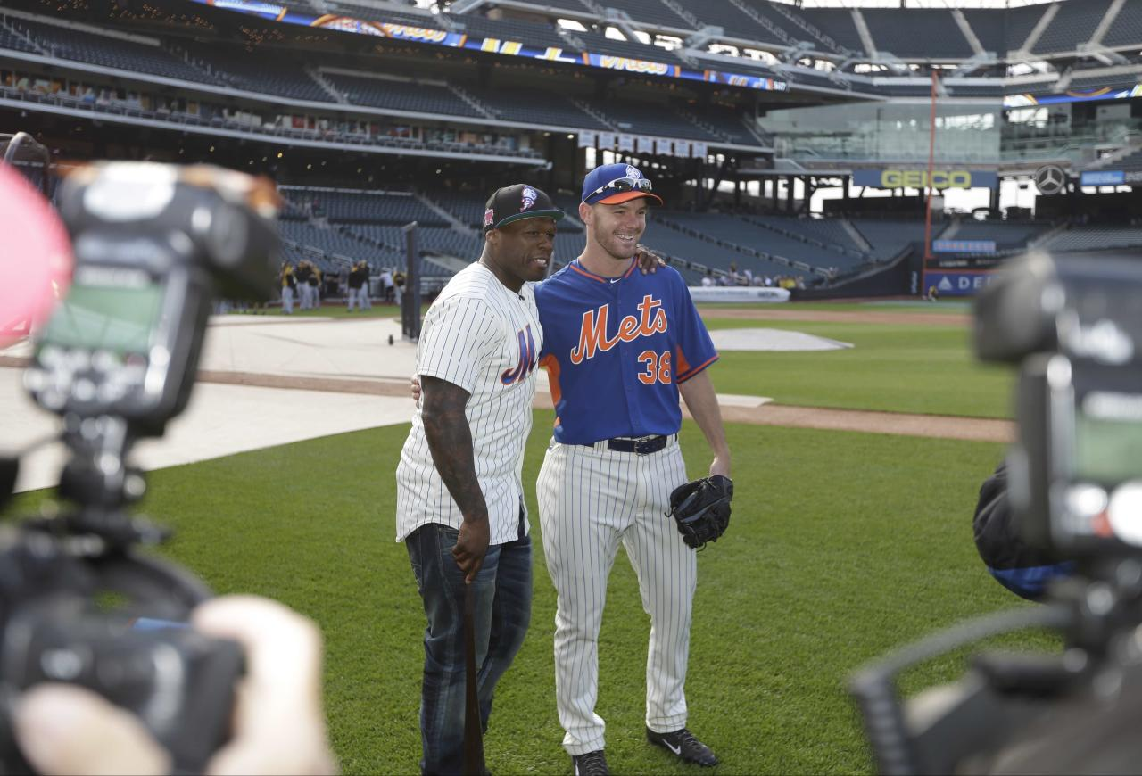 Rapper 50 Cent poses for photographs with New York Mets relief pitcher Vic Black (38) before the Mets' baseball game against the Pittsburgh Pirates Tuesday, May 27, 2014, in New York. (AP Photo/)