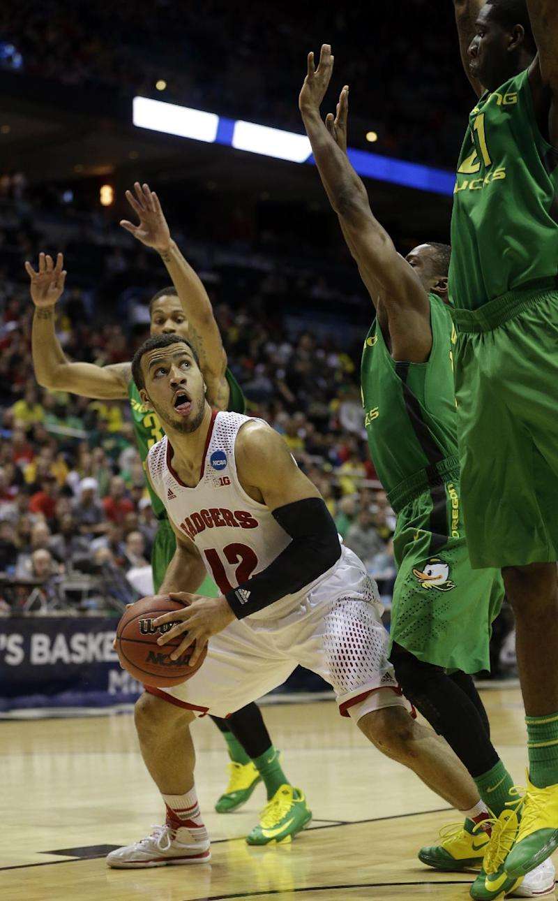 Wisconsin toughs out run to Sweet 16