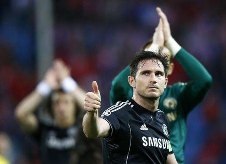Chelsea's Frank Lampard acknowledges crowd at end of his team's Champion's League semi-final first leg soccer match against Atletico Madrid at Vicente Calderon stadium in Madrid