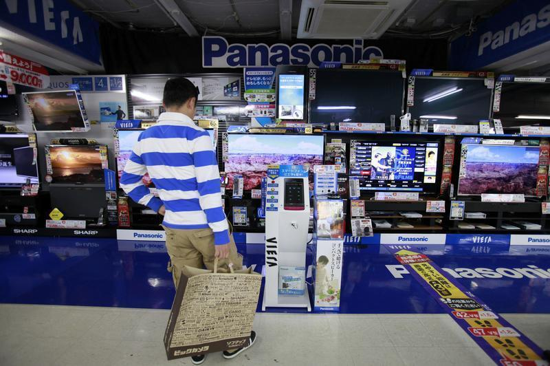 A man looks at Panasonic Corp's Viera TVs displayed at an electronics store in Tokyo