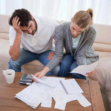 Depressed-couple-doing-their-accounting_web