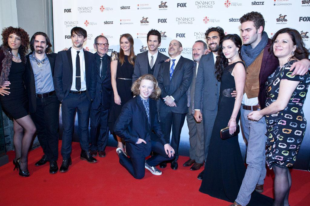 "The cast and producers of ""Da Vinci's Demons"" attend the world premiere screening at the Cinema Teatro Odeon in Florence, Italy on April 2. Left to right: Singer Raya Yarbough, composer Bear McCreary, Blake Ritson, David Schofield, Laura Haddock, Tom Riley (Da Vinci), creator/producer David S. Goyer, Allan Corduner, Gregg Chillin, Lara Pulver, Tom Bateman, executive producer Julie Gardner and seated Eros Vlahos."