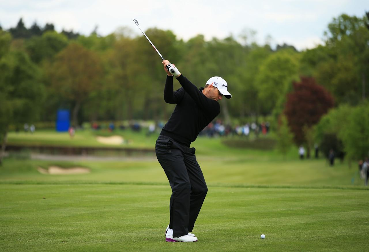 VIRGINIA WATER, ENGLAND - MAY 23:  Sergio Garcia of Spain tees off on the 8th during the first round of the BMW PGA Championship on the West Course at Wentworth on May 22, 2013 in Virginia Water, England.  (Photo by Richard Heathcote/Getty Images)
