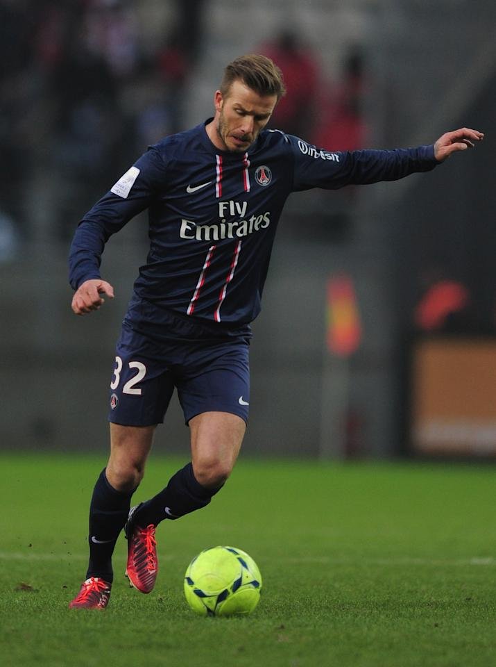 REIMS, FRANCE - MARCH 02:  David Beckham of Paris Saint-Germain in action during the Ligue 1 match between Stade de Reims Champagne v Paris Saint-Germain FC at Stade Auguste Delaune on March 2, 2013 in Reims, France.  (Photo by Jamie McDonald/Getty Images)
