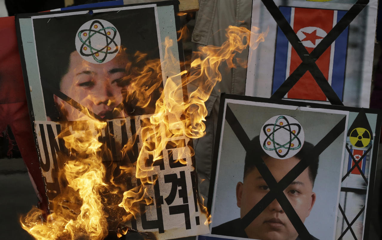 South Korean protesters in in Seoul burn pictures of North Korean leader Kim Jong Un during an anti-North Korea rally following a nuclear test conducted by North Korea Tuesday, Feb. 12, 2013. North Korea said it successfully detonated a miniaturized nuclear device at a northeastern test site Tuesday, defying U.N. Security Council orders to shut down atomic activity or face more sanctions and international isolation. (AP Photo/Lee Jin-man)
