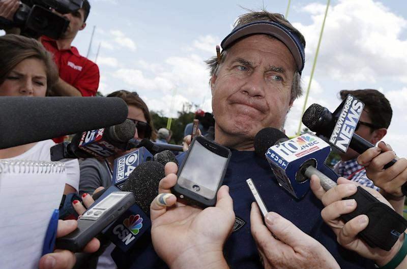 New England Patriots head coach Bill Belichick talks with reporters following NFL football minicamp in Foxborough, Mass., Wednesday, June 18, 2014