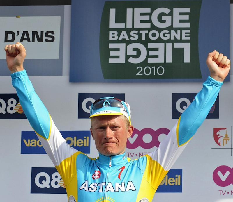 Kazakhstan's rider Alexandre Vinokourov of team Astana reacts as he celebrates his victory on the podium of the one day cycling race Liege-Bastogne-Liege, on April 25, 2010
