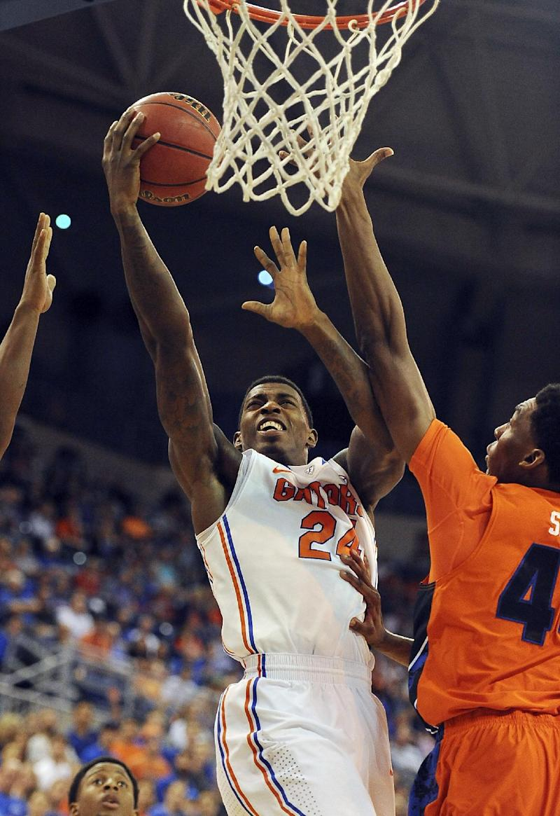 Young tops 1,000 points, No. 13 Florida wins 76-34