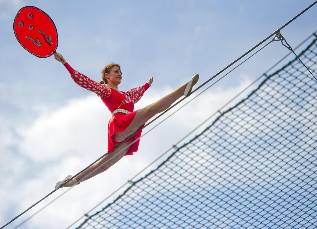 """A high-wire dancer of the acrobat group """"Geschwister Weisheit"""" (wisdom siblings) performs on the tightrope on May 25, 2013 during the German Gymnastics Festival in Frankfurt am Main, western Germany. The gymnastics competition and sports-for-all event is running until May 25, 2013 in several venues of the Rhine-Neckar region. Organisers expect more than 80,000 participants. AFP PHOTO / Nicolas Armer"""