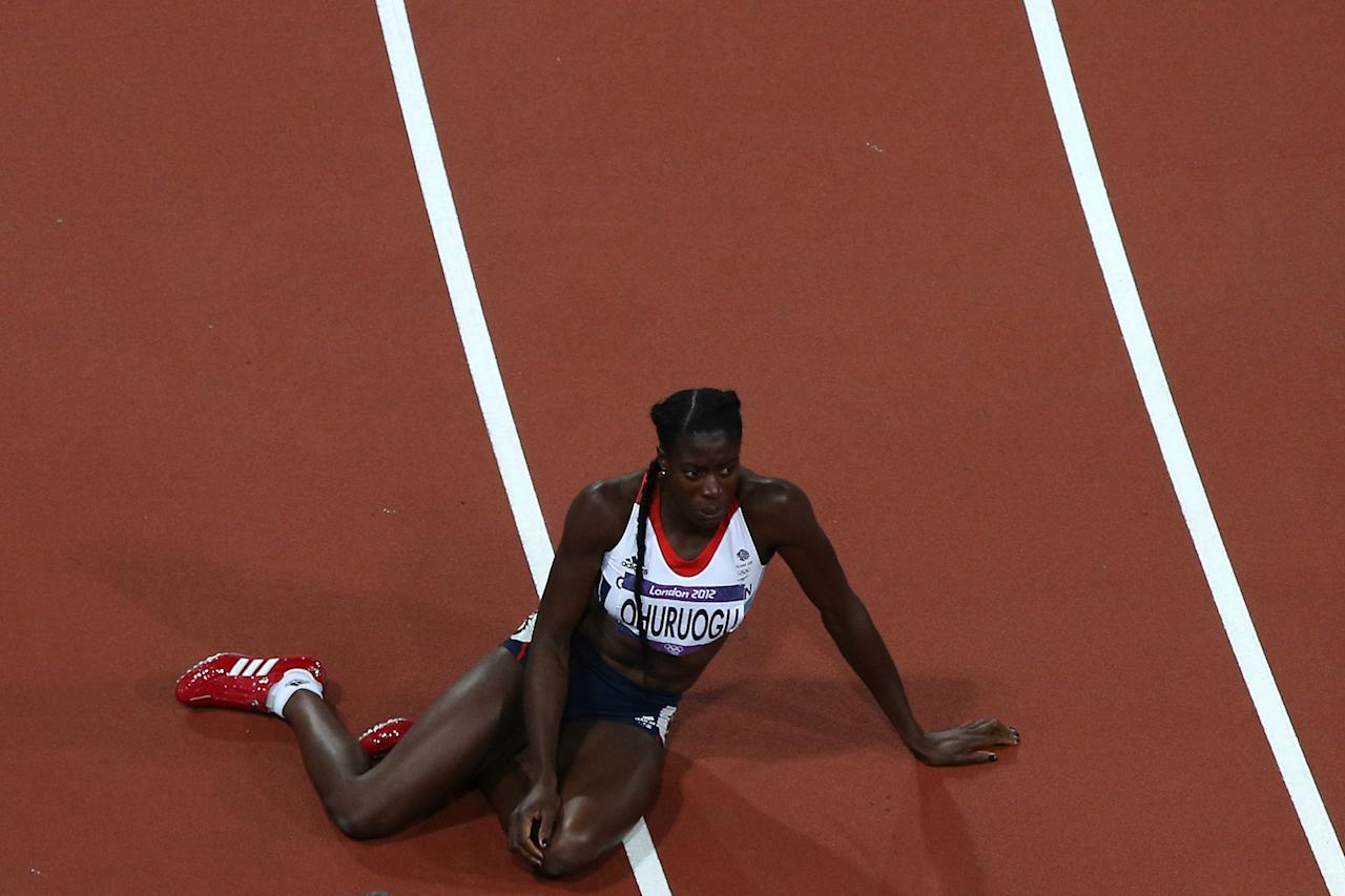 Christine Ohuruogu of Great Britain lays on the ground after winning the silver medal in the Women's 400m Final on Day 9 of the London 2012 Olympic Games at the Olympic Stadium on August 5, 2012 in London, England.  (Photo by Richard Heathcote/Getty Images)