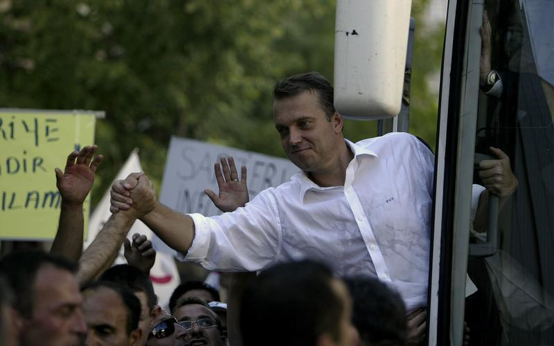 Young Party leader Uzan is greeted by supporters in the city of Bursa
