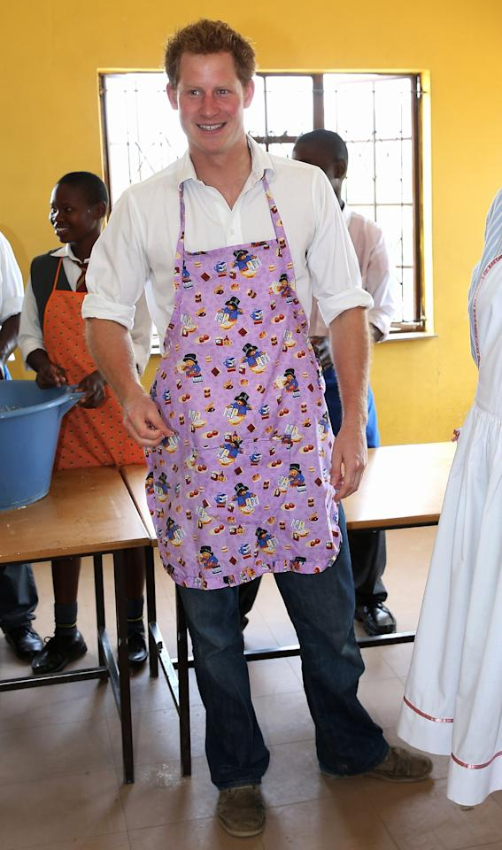 MASERU, LESOTHO - FEBRUARY 27:  Prince Harry  cooks cakes as he visits Kananelo Centre for the deaf, a project supported by his charity Sentebale on February 27, 2013 in Maseru, Lesotho. Sentebale is a charity founded by Prince Harry and Prince Seeiso of Lesotho. It helps the most vulnerable children in Lesotho get the support they need to lead healthy and productive lives. Sentebale works with local grassroots organisations to help these children, the victims of extreme poverty and Lesotho's HIV/AIDS epidemic. Cathy Ferrier was appointed as Sentebale's Chief Executive in March 2012 and is spearheading a fundraising initiative to build the Mamohato Centre which will provide psychosocial support for children and young people infected with HIV. Prince Harry is due to pay a visit to Lesotho this week to catch up on his charity's progress and meet key children who will be supported by the charity.  (Photo by Chris Jackson/Getty Images)