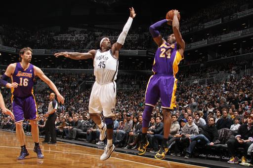 Short-handed Lakers beat Nets 92-83
