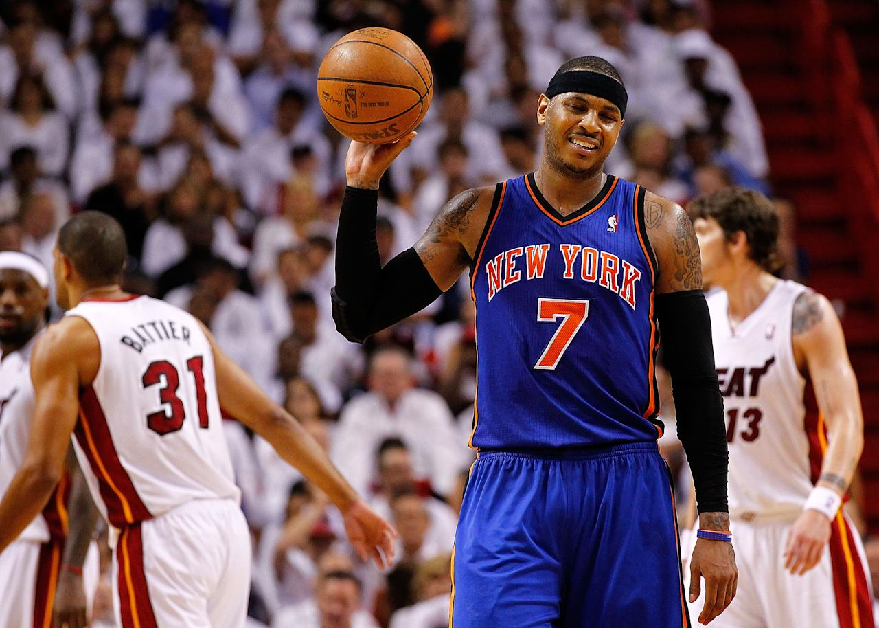 MIAMI, FL - APRIL 30:  Carmelo Anthony #7 of the New York Knicks reacts to committing a foul during Game Two of the Eastern Conference Quarterfinals in the 2012 NBA Playoffs  against the Miami Heatat American Airlines Arena on April 30, 2012 in Miami, Florida. NOTE TO USER: User expressly acknowledges and agrees that, by downloading and/or using this Photograph, User is consenting to the terms and conditions of the Getty Images License Agreement.  (Photo by Mike Ehrmann/Getty Images)