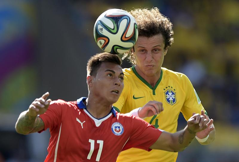 Chile's forward Jorge Valdivia (L) and Brazil's defender David Luiz vie for the ball during the match between Brazil and Chile at the Mineirao Stadium in Belo Horizonte during the World Cup on June 28, 2014