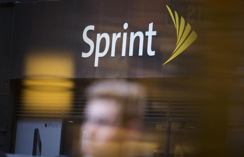File photo of people walking past a Sprint store in New York