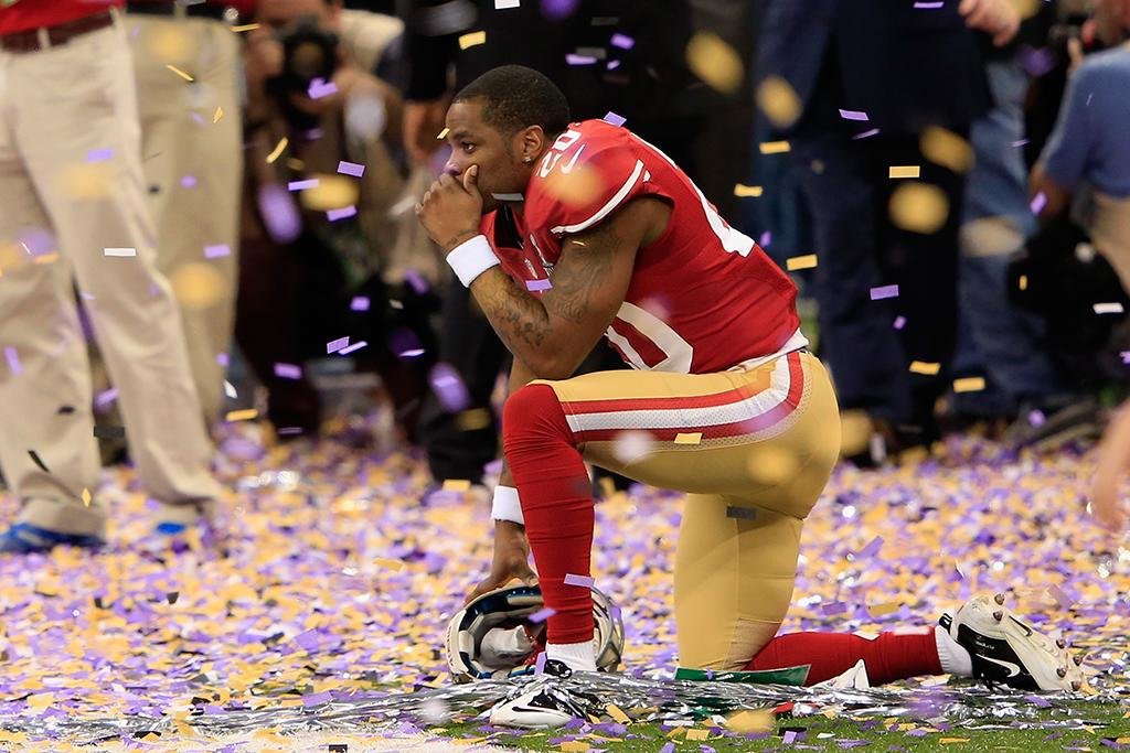 Perrish Cox #20 of the San Francisco 49ers kneels down among the confetti following their loss to the Baltimore Ravens during Super Bowl XLVII at the Mercedes-Benz Superdome on February 3, 2013 in New Orleans, Louisiana. The Ravens defeated the 49ers 34-31. (Photo by Jamie Squire/Getty Images)