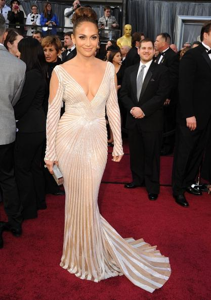 """<div class=""""caption-credit""""> Photo by: Getty Images</div><div class=""""caption-title"""">JLo at the Oscars</div>The only other Latina on Forbes' """"The Best Dressed at the Oscars"""" list was diva Jennifer Lopez who wore a creamy gown from Zuhair Murad- one of her favorite designers. This fashionista was actually kept away from many of this year's glamorous red carpets as she traveled the world for her international music tour."""