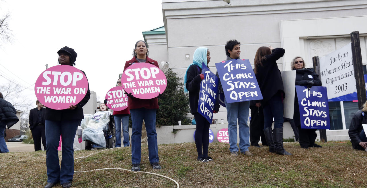 Abortion rights supporters stand outside the Jackson Women's Health Organization Inc., Mississippiís only commercial abortion clinic in Jackson, Miss., Tuesday, Jan. 22, 2013. Activists pro-and anti-abortion marked 40 years since a U.S. Supreme Court ruling established a nationwide right to abortion, with protests at the Capitol and at the clinic. (AP Photo/Rogelio V. Solis)