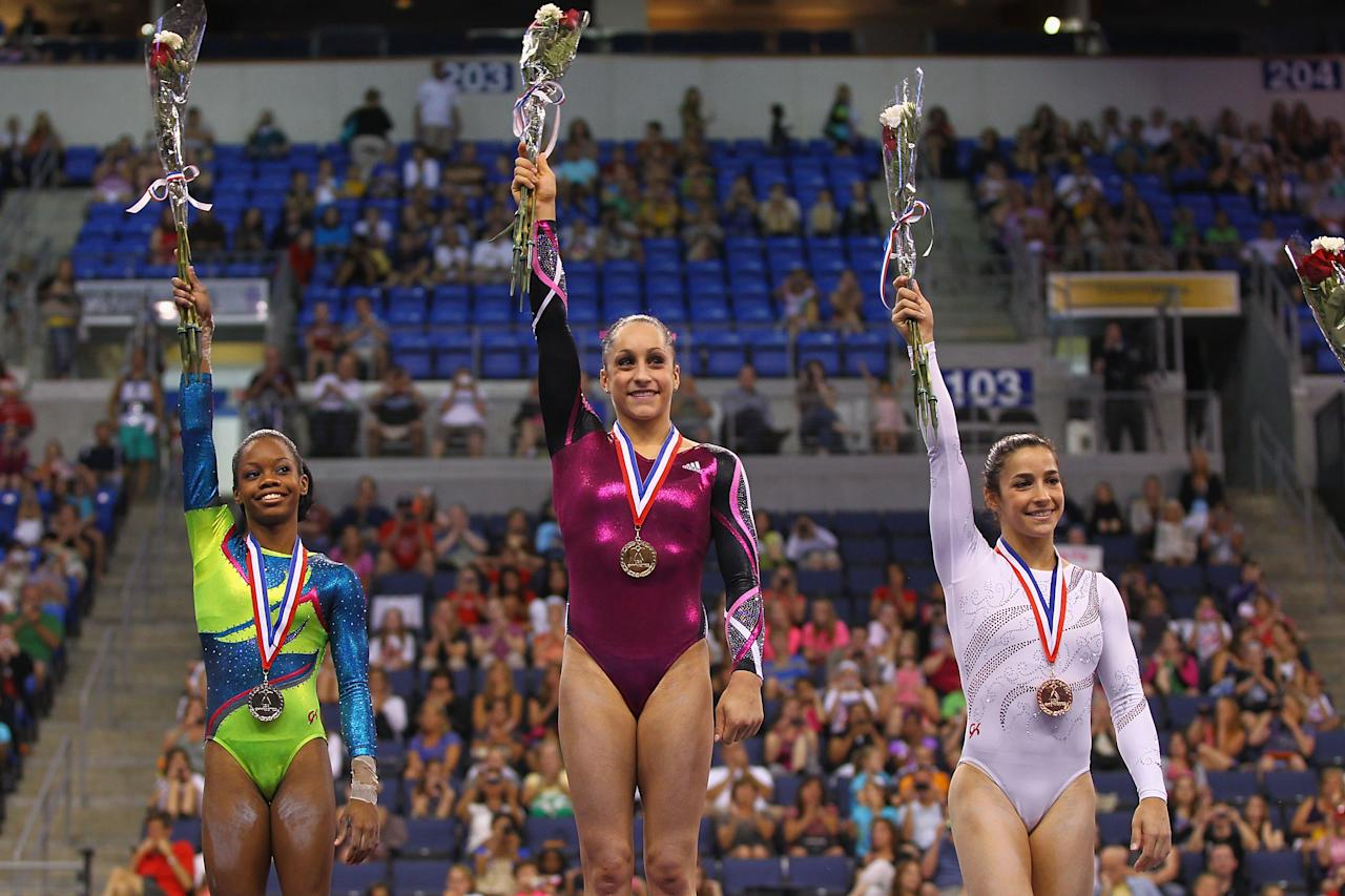 ST. LOUIS, MO - JUNE 10: (L - R) Silver medalist Gabrielle Douglas, gold medalist Jordyn Wieber and bronze medalist Alexandra Raisman acknowledge the crowd after winning the Senior Women's competition on day four of the Visa Championships at Chaifetz Arena on June 10, 2012 in St. Louis, Missouri.  (Photo by Dilip Vishwanat/Getty Images)
