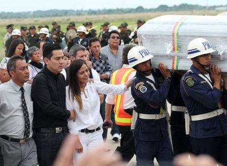 Relatives of Bolivian crew member Sisy Arias, who died when the plane carrying Brazilian soccer team Chapecoense crashed in Colombia, react as the bodies of victims arrive at Viru Viru airport in Santa Cruz