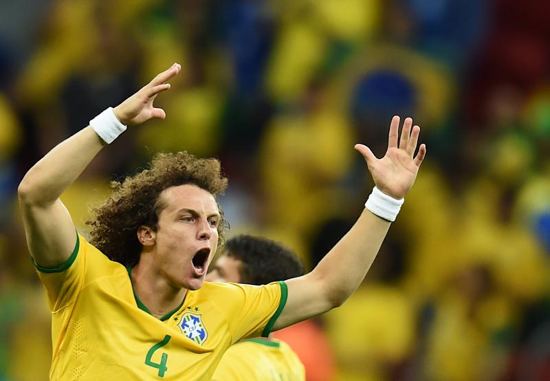 Brazil defender David Luiz celebrates after forward Fred (not pictured) scored during a World Cup Group A match against Cameroon at the Mane Garrincha National Stadium in Brasilia on June 23, 2014