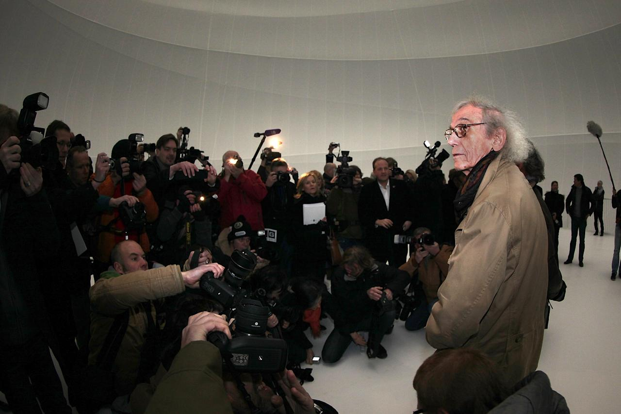 OBERHAUSEN, GERMANY - MARCH 15: Bulgarian-born artist Christo, known for his large-scale environmental art, leads journalists through his Big Air Package, his latest work in a former gas storage facility called the Gasometer on March 15, 2013 in Oberhausen, Germany. The piece is made from 5.3 tons of translucent material covering 20,350 square meters and shaped with 4.500 meters of cable, and fills the interior of the facility. The installation will be open to the public from March 16 through December 30. (Photo by Hannelore Foerster/Getty Images)